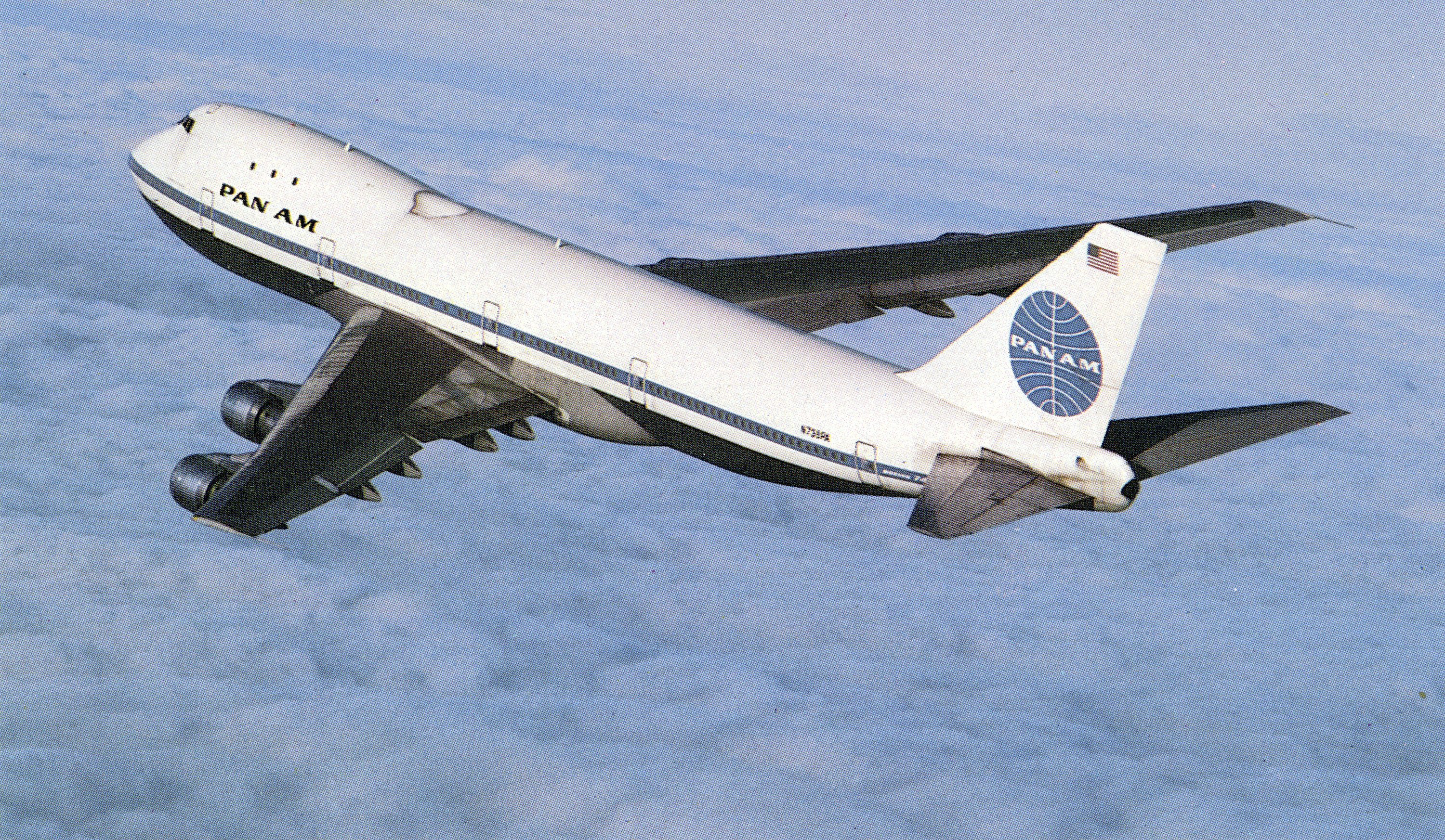 """High one-half left rear view of Pan American Boeing Model 747-121 """"Clipper Queen of the Seas"""" (also named """"Clipper Westwind"""") (r/n N753PA, c/n 19657) in flight over cloud layer. Color postcard."""